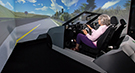 Das Bild zeigt eine Seniorin im Fahrsimulator (refer to: Assessing fitness-to-drive in the elderly by means of a driving simulator - Feasibility study)