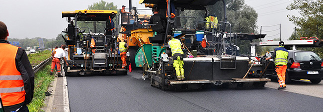 The photo shows  an Asphalt Paver