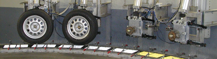 The photo shows the Turntable Road-Marking Test System